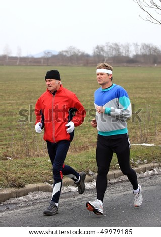 Runners while training in a cloudy day - stock photo