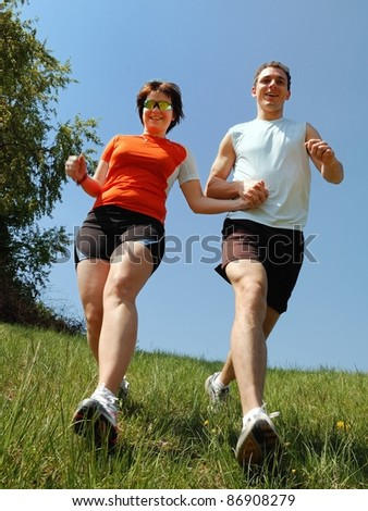 Running boy and girl