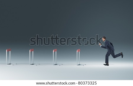 running businessman and 3d obstacle