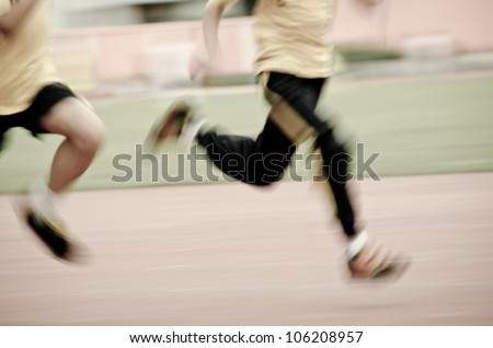 running child on sport track, blurred motion abstract background