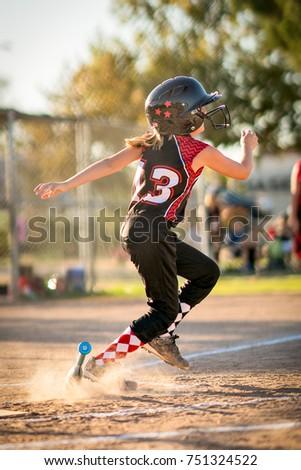 Running child playing baseball or softball #751324522