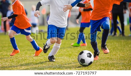 Running Children Football Soccer Players with Ball. Footballers Kicking Football Match on the Pitch. Young Teen Soccer Game. Youth Sport Background #727193797