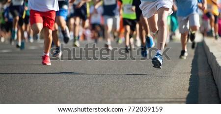Running children, young athletes run in a kids run race #772039159
