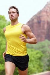 Running fitness man sprinting outdoors in beautiful landscape. Fit male runner training for marathon. Caucasian sport model.