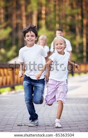 Running happy kids outdoors