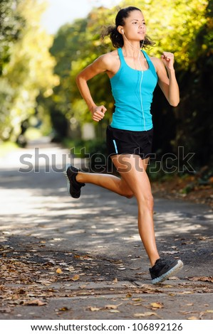 running healthy fitness woman training for marathon outdoors in alleyway. vitality lifestyle exercise athlete.