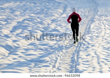 Running in snow - stock photo