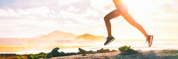 Running legs silhouette of runner woman trail running on ultra mountain race on beach landscape panoramic banner. Sprinting athlete panorama.