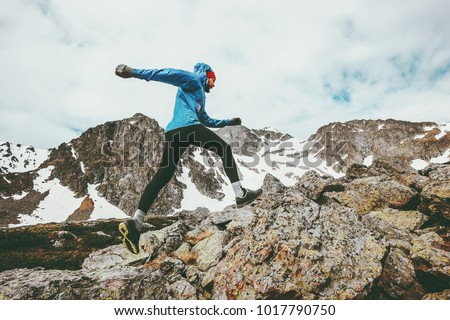 Running Man active vacations in mountains travel adventure healthy lifestyle endurance concept skyrunning sport
