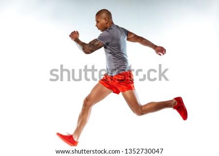 Running. Man in running suit running very fast