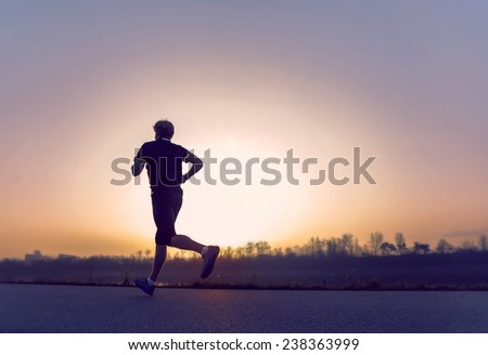Running man silhouette in sunset time #238363999