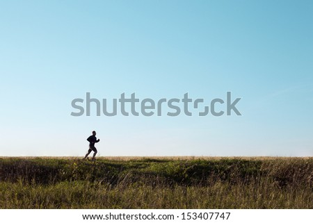 Running man sprinting cross country