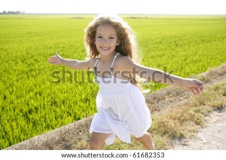running open arms little happy girl green meadow field track