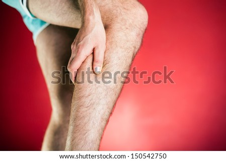 Running physical injury, leg calf pain. Runner sore body after exercising, red background