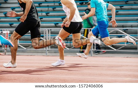 running race men sprinter athletes in track and field competition