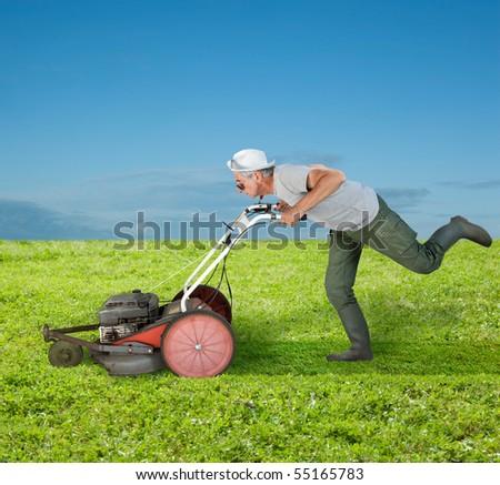Running senior mowing a green field.