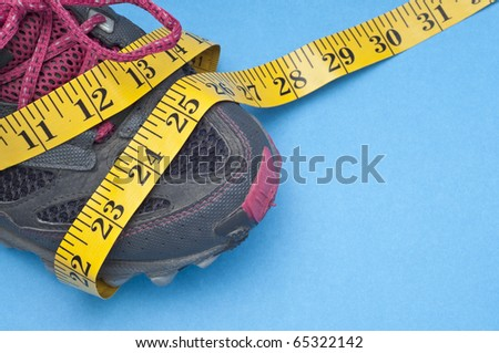 Running Shoe with Measuring Tape Health and Fitness Concept.