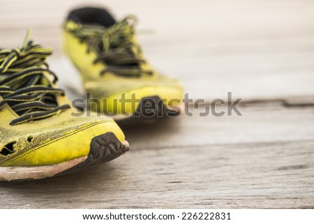 Running shoes on a wooden background #226222831