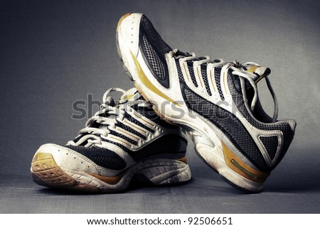 Running shoes on grey background.