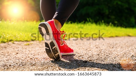 Running shoes runner woman run in forest park at summer. Jogging girl exercise motivation heatlh and fitness. ストックフォト ©