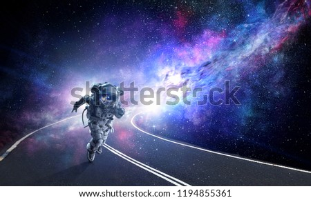 Running spaceman and galaxy. Mixed media