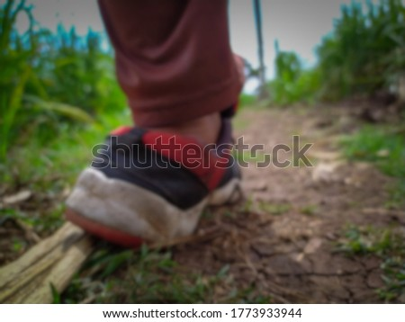 Running sport shoe in feet cramped on dry farm land related blur