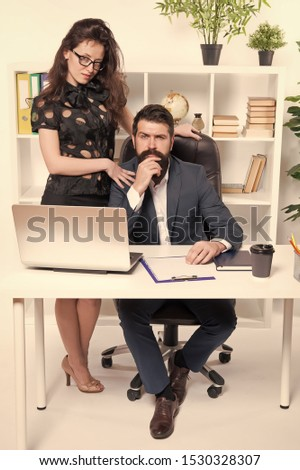 Running startup business together. Confident businessman and woman working in startup company. Startup project managers in office. Co-founders of startup or start up.
