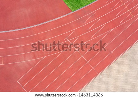 running track background. cinder track in detail in a stadium