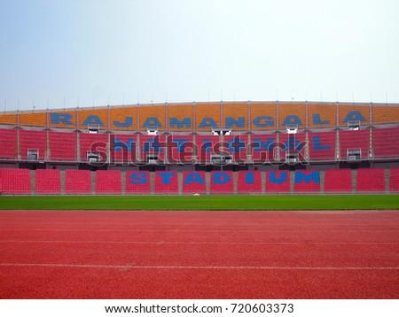 Running track, football field and colorful seat of Rajamangala National public stadium, Bangkok, Thailand