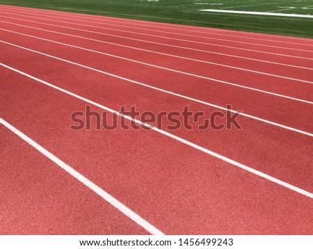 Running track lanes on sports field.