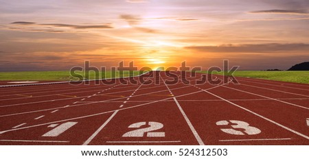 Running track with lanes over sky and clouds