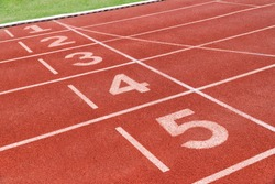 Running track with number in stadium. Close up start position in athlete track.