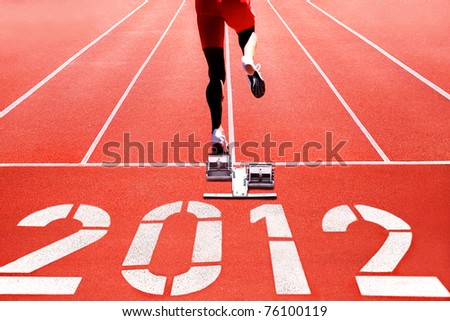 Running track with runner on start numerals of year 2012