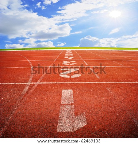 Running track  with sky cloud - stock photo
