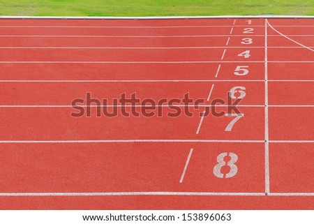 Running tracks at finished position red rubber floor with white line. number 1 to 8 .