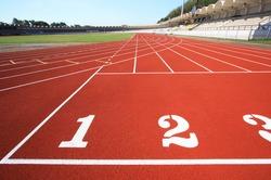 Running tracks in an empty stadium from Thailand.