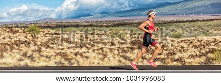 Running triathlon man athlete runner panoramic banner. Triathlete working out in tri suit. Sport athlete on marathon run training exercising cardio in professional outfit for triathlon.