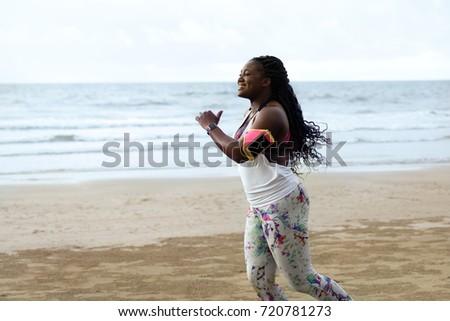 running woman. female african...