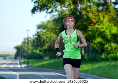 Running woman. Female Runner Jogging during Outdoor Workout in a Park. Beautiful fit Girl. Fitness model outdoors. Weight Loss.