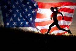 Running woman. Runner jogging over sunset sky and american flag. Female fitness model training outside running to her American dream