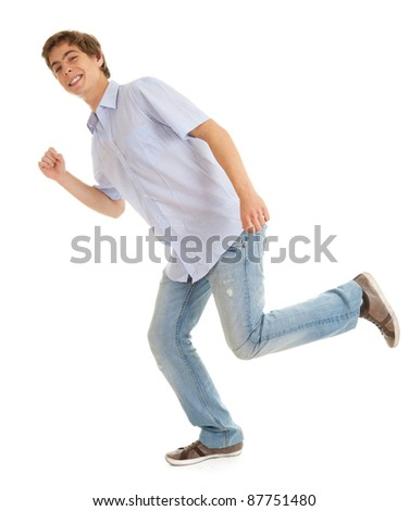 running young man  in bright shirt, white background