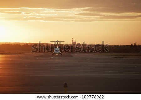 Runway at sunset - back lit