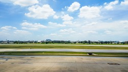 Runway on a beautiful sky and clouds background.