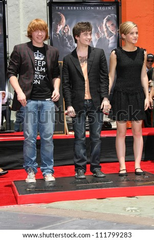 "Rupert Grint with Daniel Radcliffe and Emma Watson at the Hand, Foot and Wand Print Ceremony Honoring The Cast of ""Harry Potter"". Grauman's Chinese Theater, Hollywood, CA. 07-09-07 - stock photo"