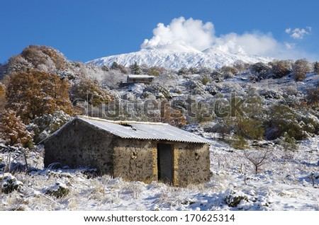 rural area under Etna volcano covered by snow, Sicily