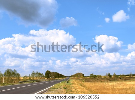Rural autumn landscape with old road