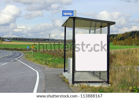 Rural bus stop shelter with blank billboard for your advertisement.