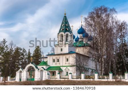 Rural cemetery and rural temple. Yaroslavl region, Russia #1384670918