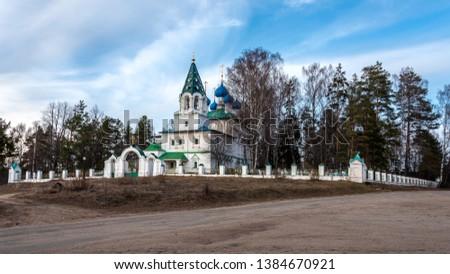 Rural cemetery and rural temple. Yaroslavl region, Russia #1384670921