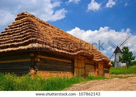 Rural cottage in small village on sunny day,Tokarnia, Poland